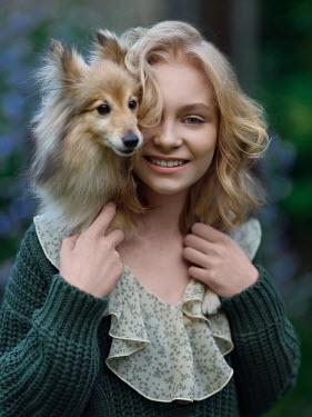 Alexey Kazantsev HAPPY BLONDE GIRL WITH DOG ON SHOULDER