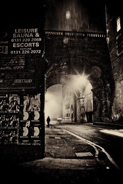 Laurence Winram FIGURE WALKING UNDER CITY BRIDGE