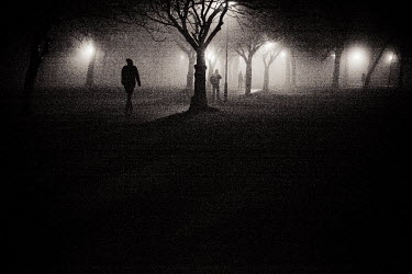 Laurence Winram PEOPLE WALKING BY TREES AND LIT STREETLIGHTS