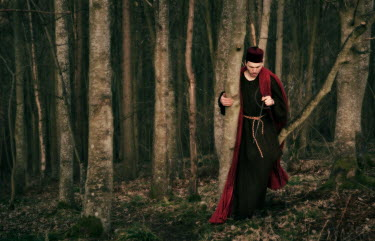 Laurence Winram MAN IN FEZ AND ROBE IN WOODS