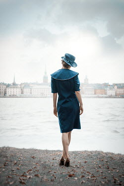 Natasza Fiedotjew Vintage woman standing by river watching city