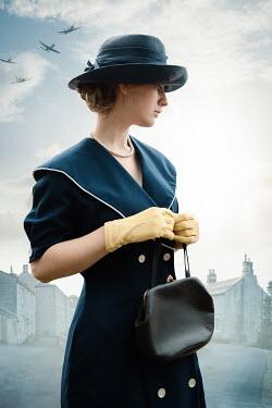 Natasza Fiedotjew Aeroplanes flying toward vintage woman in hat holding purse