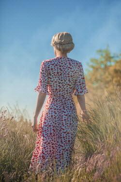 Ildiko Neer Blonde woman standing in meadow