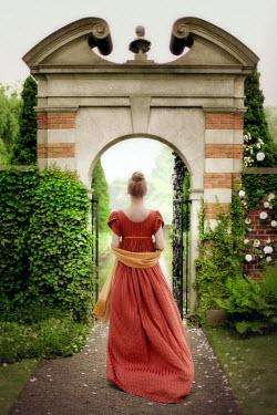 ILINA SIMEONOVA REGENCY WOMAN WALKING THROUGH GARDEN ARCHWAY