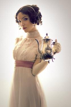 ILINA SIMEONOVA REGENCY WOMAN HOLDING SILVER COFFEE POT