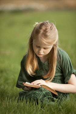 Laurence Winram GIRL IN GREEN DRESS READING BOOK OUTDOORS