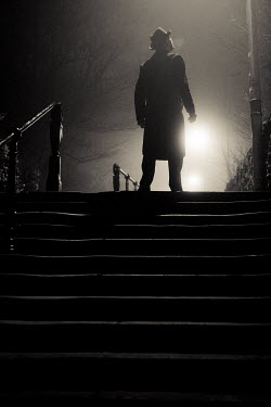 Laurence Winram MAN STANDING BY STEPS AT NIGHT
