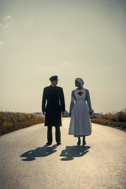 Magdalena Russocka wartime soldier and nurse on country road at sunset