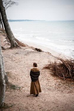 Natasza Fiedotjew Historical woman walking on cliff by sea