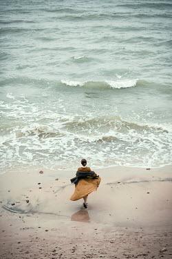 Natasza Fiedotjew Historical woman dancing on beach by sea