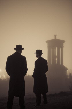 Laurence Winram TWO MEN STANDING BY MONUMENT IN MIST