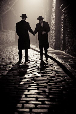 Laurence Winram TWO MEN SHAKING HANDS IN COBBLED STREET