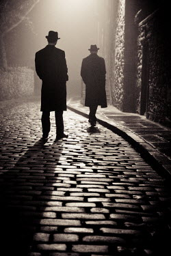 Laurence Winram TWO MEN IN HATS IN COBBLED STREET