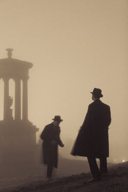 Laurence Winram TWO MEN BY MONUMENT IN FOG