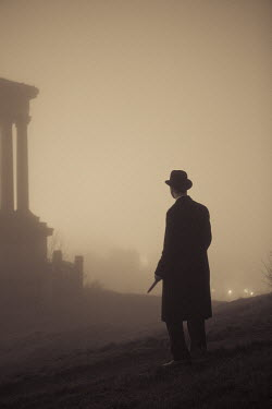 Laurence Winram MAN STANDING BY MONUMENT IN FOG