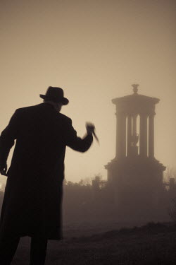 Laurence Winram MAN WITH KNIFE BY MONUMENT IN FOG