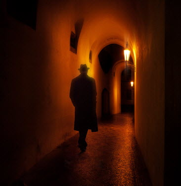 Laurence Winram MAN IN HAT WALKING IN HALLWAY