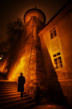 Laurence Winram MAN CLIMBING STEPS BY BUILDING AT NIGHT