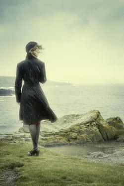 Laurence Winram WOMAN IN RAIN BY SEA