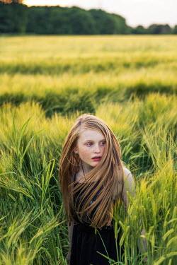 Laurence Winram TEENAGE GIRL IN LONG GRASS