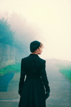 Laurence Winram WOMAN IN HAT ON MISTY ROAD
