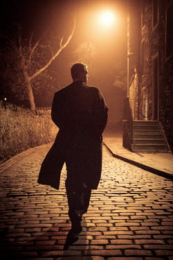 Laurence Winram MAN ON COBBLED STREET AT NIGHT