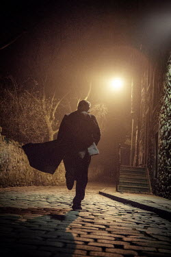 Laurence Winram MAN IN OVERCOAT AT NIGHT