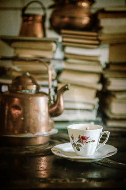 Natasza Fiedotjew Flowery cup of hot tea in front of piled books