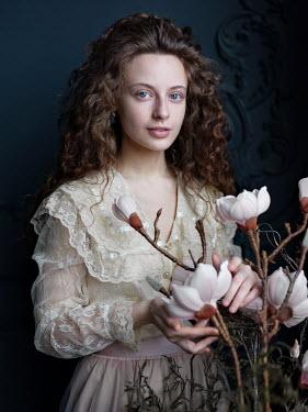 Alexey Kazantsev HISTORICAL WOMAN ARRANGING MAGNOLIA FLOWERS