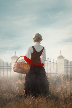 Ildiko Neer Historical woman standing in grass by gate