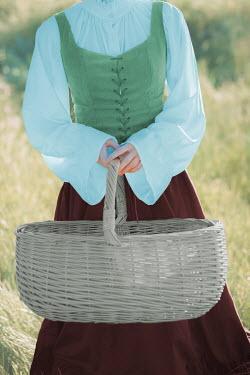 Ildiko Neer Historical woman holding basket