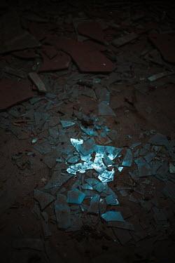 Joanna Jankowska BROKEN GLASS AND TILES ON FLOOR