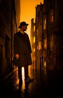 Laurence Winram RETRO MAN SMOKING IN CITY AT NIGHT
