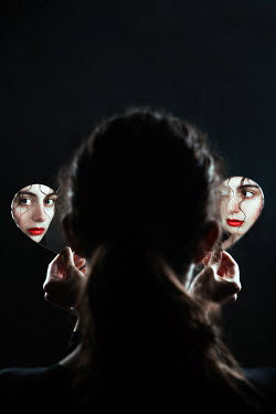 Magdalena Russocka face of woman reflecting in two heart shaped mirrors
