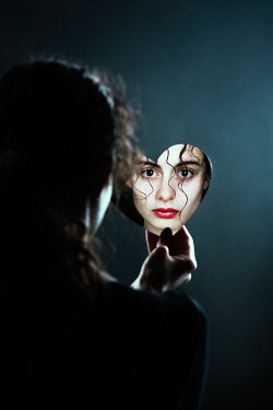 Magdalena Russocka face of woman reflecting in heart shaped mirror