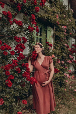Nadja Berberovic PREGNANT WOMAN OUTSIDE HOUSE WITH ROSES