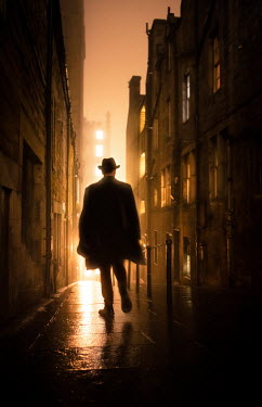 Laurence Winram RETRO MAN IN HAT IN CITY STREET AT NIGHT