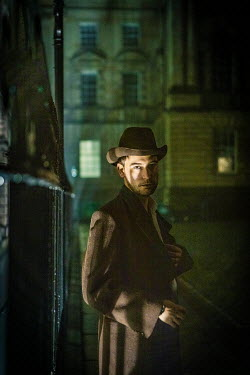 Laurence Winram MAN IN HAT IN CITY AT NIGHT