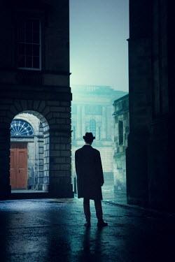 Laurence Winram RETRO MAN IN CITY AT NIGHT