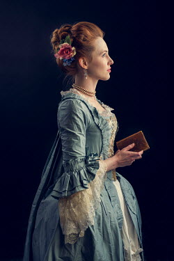 Laurence Winram Young woman in Victorian gown holding book