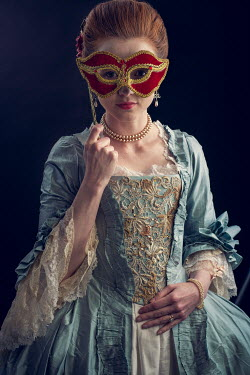 Laurence Winram Young woman in Victorian gown and masquerade mask
