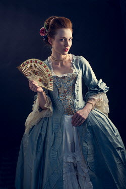 Laurence Winram Young woman in Victorian gown holding fan