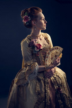 Laurence Winram Young woman in Victorian gown with fan