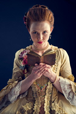 Laurence Winram Young woman in Victorian gown with book