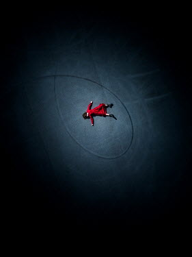 Magdalena Russocka woman in red dress lying down on tarmac from above