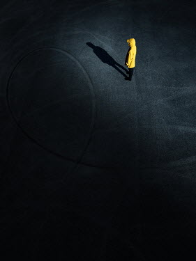 Magdalena Russocka woman in yellow hooded jacket standing on tarmack from above at night