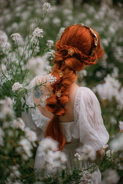 Rebecca Stice WOMAN WITH RED HAIR IN MEADOW OF WHITE FLOWERS
