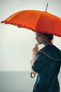 Natasza Fiedotjew Close up of vintage woman with umbrella in rain