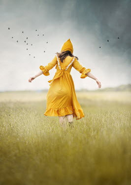 Anna Buczek GIRL IN YELLOW DRESS AND HAT IN COUNTRYSIDE