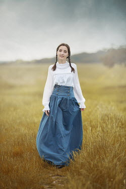Anna Buczek GIRL WITH PLAITS AND LONG SKIRT IN COUNTRYSIDE